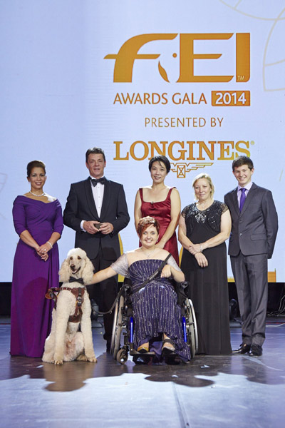 "Equestrian heroes were celebrated tonight at the glittering FEI Awards 2014, the ""Oscars of the equestrian world"", presented by Longines in Baku's fabulous Buta Palace (left to right): HRH Princess Haya, Jeroen Dubbeldam (NED), Melissa Tan (SIN) chairman of equine therapy centre Equal Ark, Jackie Potts (GBR), Lambert Leclezio (MRI) with (centre) Sydney Collier (USA) and her service dog Journey. © FEI/Liz Gregg"
