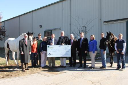 EEI Executive Director Lee Carter and President Stewart Perry present donations to Midway College