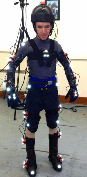 A jockey posing with the inertial measurement units attached to various points across his body, before mounting the racehorse simulator. Photo: Royal Veterinary College