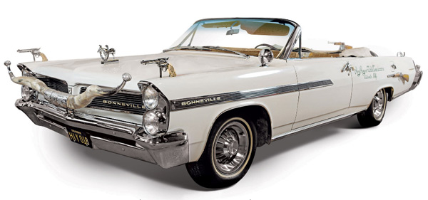 Roy's silver-dollar-encrusted Bonneville convertible car sold for $254,500. Interior and detailed images below.