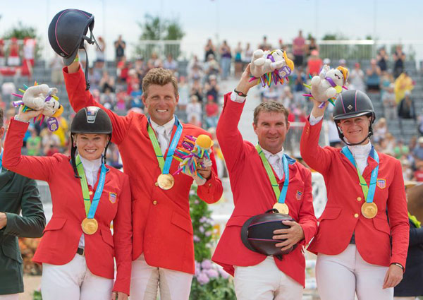 The USA's Gold Medal Eventing Team on the podium, from left, Marilyn Little, Boyd Martin, Phillip Dutton and Lauren Kieffer.