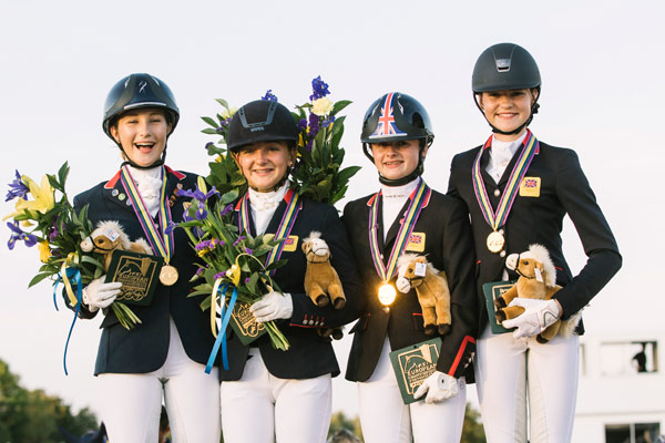 Britain's winning pony dressage team members, from left, Rebecca Bell, Isobel Berrington, Phoebe Peters and Clare Hole.