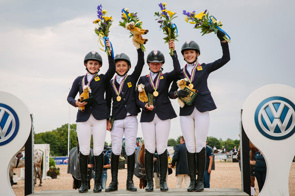 Britain's winning pony showjumping team, from left, Charlotte Ash, Jack Whitaker,  Jodie Hall Mcateer, and Jessica Hewitt.