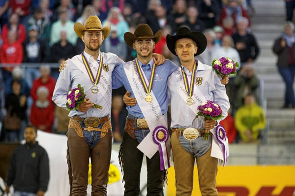 The individual medal podium at the FEI European Reining Championships (from left), silver medalist Grischa Ludwig (GER), gold medalist Giovanni Masi de Vargas (ITA), and bronze medalist Elias Ernst (GER).