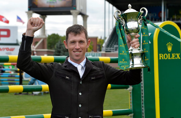 Scott Brash, the first rider to win the Rolex Grand Slam of Show Jumping, with the Rolex Grand Slam Trophy.