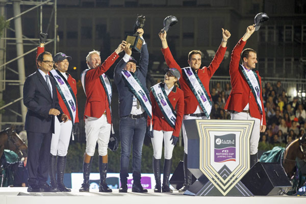 Celebrating the Belgian team's victory at the Furusiyya FEI Nations Cup Jumping Final in Barcelona, Spain, on Saturday night, from left, Prince Mansur bin Khalid al Farhan al-Saud (Saudi Ambassador to Spain), Gudrun Patteet, Jos Lansink, Dirk Demeersman, Judy Ann Melchior, Olivier Philippaerts and Gregory Wathelet.