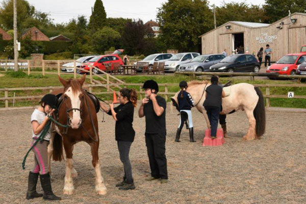 Preparing to mount up and ride at The Mill Riding Centre in Pattingham.