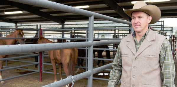 Garret Leonard, director of the Dumb Friends League Harmony Equine Center, surveys 23 horses recovering from surgery.