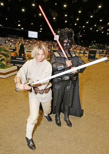 Kaley Cuoco as Luke Skywalker and Tracy Wade as Darth Vader get into character for the Charity Pro-Am Style & Competition at the Longines Masters of Los Angeles.