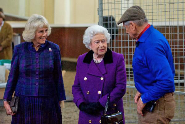 Camilla, the Duchess of Cornwall, and Queen Elizabeth II chat with Brooke Global Ambassador Monty Roberts at an event for Brooke supporters on October 21.