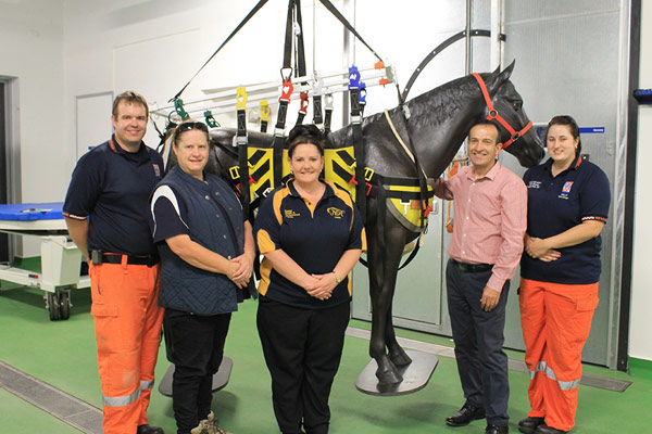 From left,Ben Birbeck, SA SES; Julie Fiedler Horse SA; Casey Hogan, University of Adelaide Equine Health & Performance Centre Practice Manager; The Hon. Tony Piccolo MP, Minister for Emergency Services; and Sally Equid SA SES with 'Blackie' the horse.