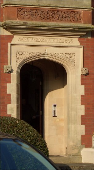 The doorway with the motto over the top
