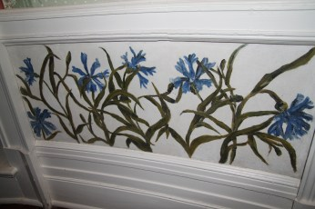 Flowers painted on the wall in the office.