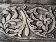 Flowers carved into the historic architecture of Olympia, Greece