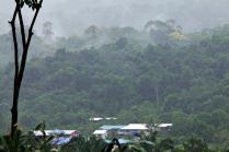 The walk back to Long Lellang from Long Kepang and view of Long Lellang on a rainy, misty morning