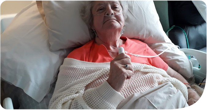 Margaret Palmer enjoys the cool air of a fan supplied by HospiceAid UK