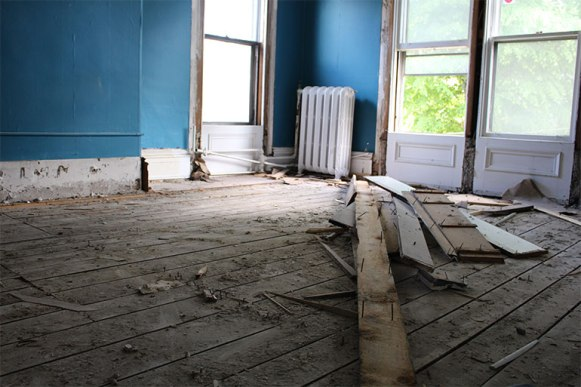 Floor boards in an upstairs room await their removal.