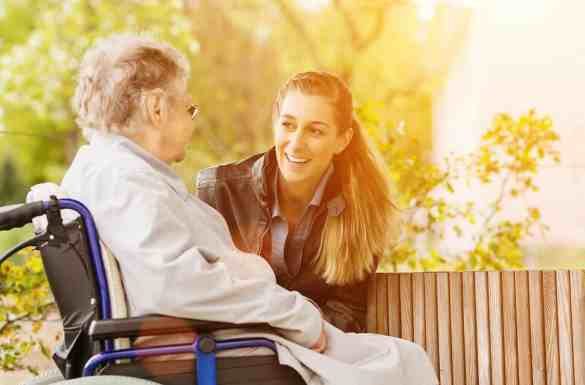Daughter communicating with hospice care parent