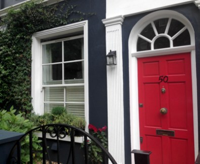 The outside of a home in London's Kensington Borough. I love the complementing colors.