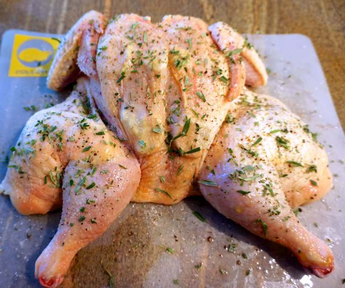 Herb Roasted Chicken is moist, tender and delicious. Slathering it with herb butter and cooking it on a grill guarantees crispy, beautiful skin. | HostessAtHeart.com