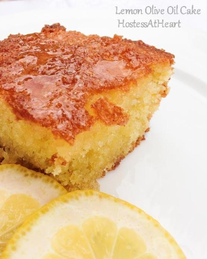 The color of this Lemon Olive Oil Cake is gorgeous, the smell is amazing, and best of all, it's easy to put together. It tastes like summer all year long. - HostessAtHeart
