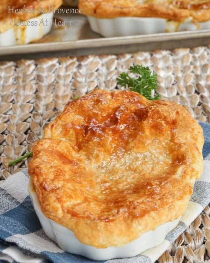 Herbes de Provence Pot Pie is proof that comfort food can be delicious without the extra fat and calories. You will not miss the meat in this vegetarian version either. | HostessAtHeart.com