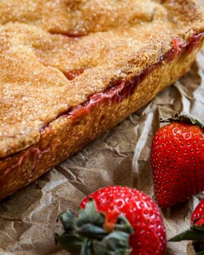 Beautiful and rustic Strawberry Slab Pie has a sweet crunchy, buttery crust that's filled with a delicious thick strawberry filling. - Hostess At Heart