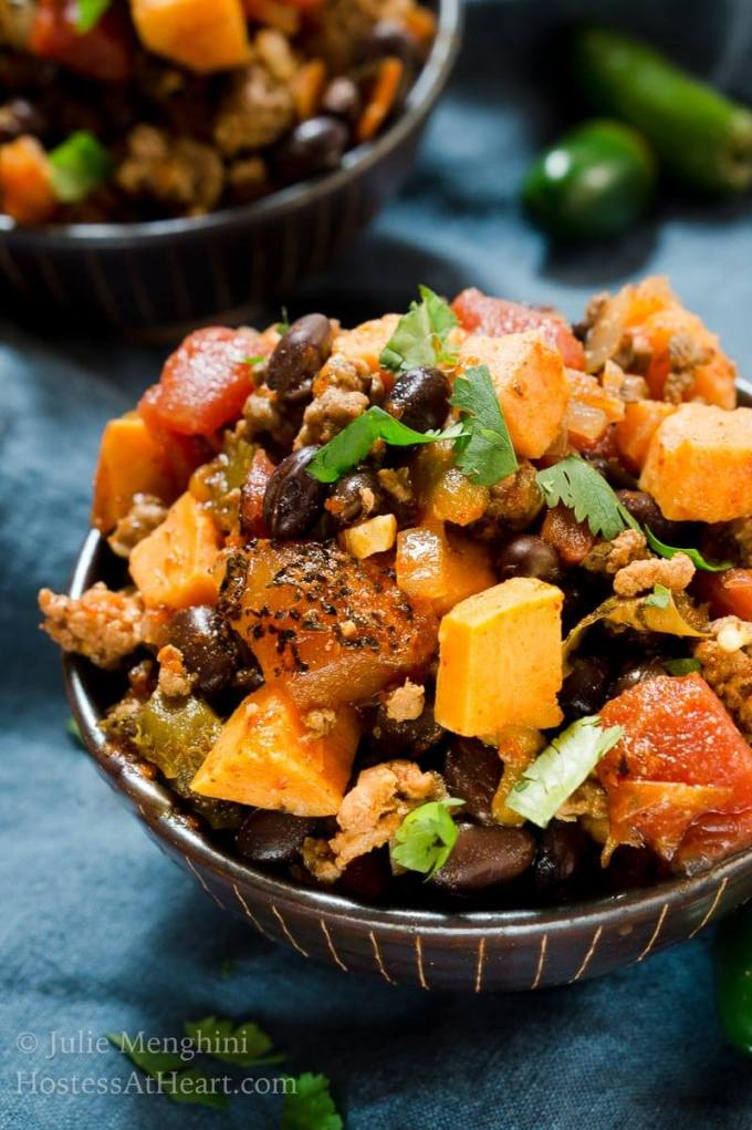 Sweet Potato and Black Bean Chili is a warm and filling dish that's packed with protein, delicious ingredients, and no guilt!   HostessAtHeart.com