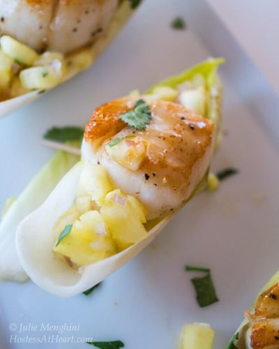 Scallops with Pineapple Salsa and Plum Wasabi Drizzle | Scallops with Pineapple Salsa and Plum Wasabi Drizzle make an impressive appetizer. No one needs to know how quick and easy it is to make.