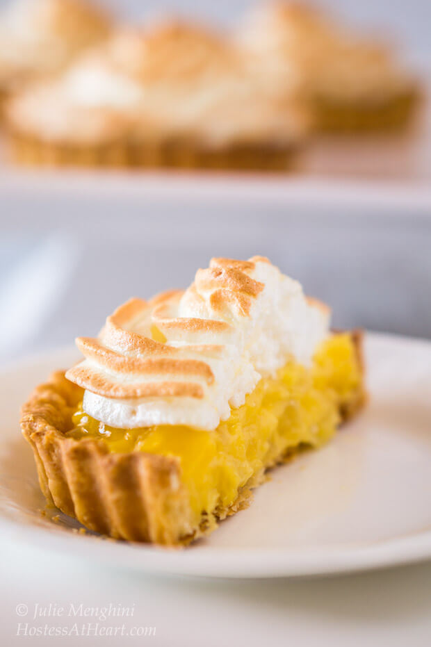Pineapple Cream Meringue tarts have a smooth and luscious filling that sits in a buttery flakey crust | HostessAtHeart.com