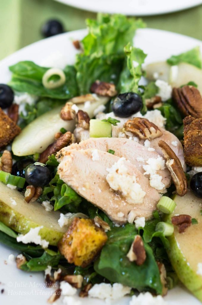 Chicken Pear Salad with Goat Cheese sounds like a mouthful to say, but I'll guarantee you'll be eating mouthfuls of this salad once you've tried the Pear Dressing | HostessAtHeart.com