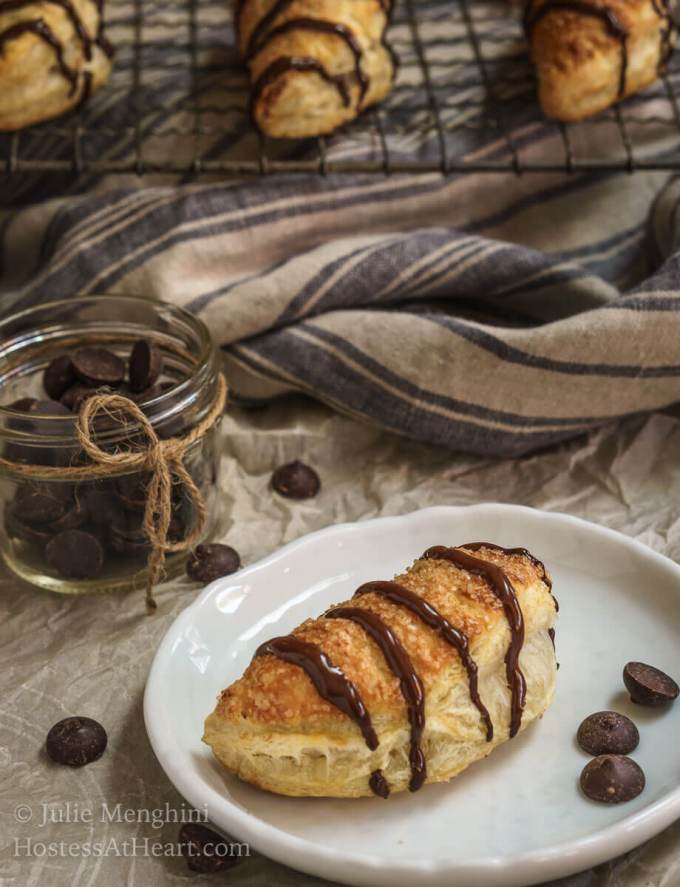 Dark Chocolate Puff Pastry Hand Pies have a light, airy and soft interior enhanced by a deep dark chocolate. The whole thing is wrapped in a golden brown Puff Pastry with a delicate crunch. | HostessAtHeart.com