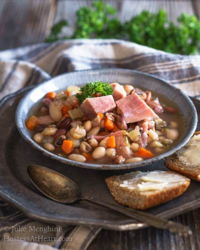 This Ham and Bean Soup Recipe is perfect for lunch or dinner. It's a hearty protein-packed soup that will keep you satisfied long after a meal. | HostessAtHeart.com