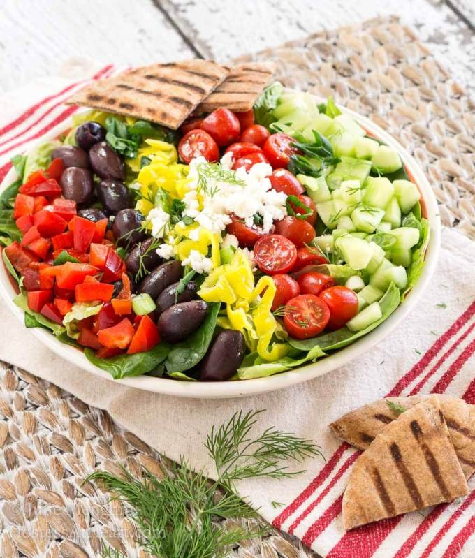 This Fresh Greek Salad with Lemon Vinaigrette has a ton of flavors and textures and it tastes nice and bright from the lemon vinaigrette. | HostessAtHeart.com