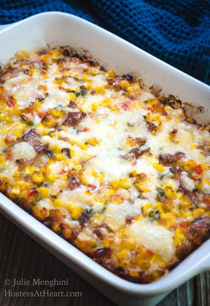 Roasted Corn and Bacon Casserole is so delicious and quick and easy to put together!  Every bite tastes just like the best parts of summer but this version is delicious any time of year! | HostessAtHeart.com