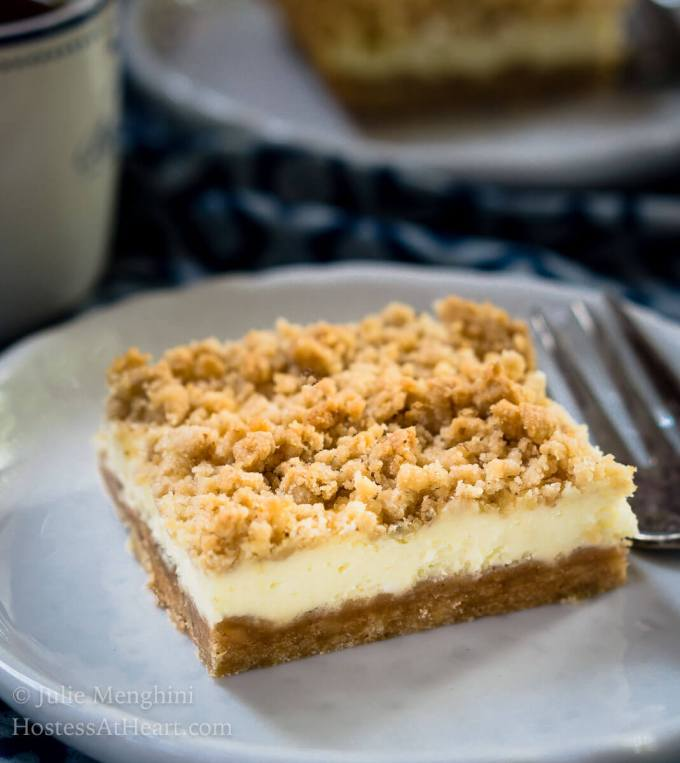 These Cheesecake Cookie Bars are So Good.  They're quick and easy to make and taste like a fancy cheesecake without all of the fuss. | HostessAtHeart.com