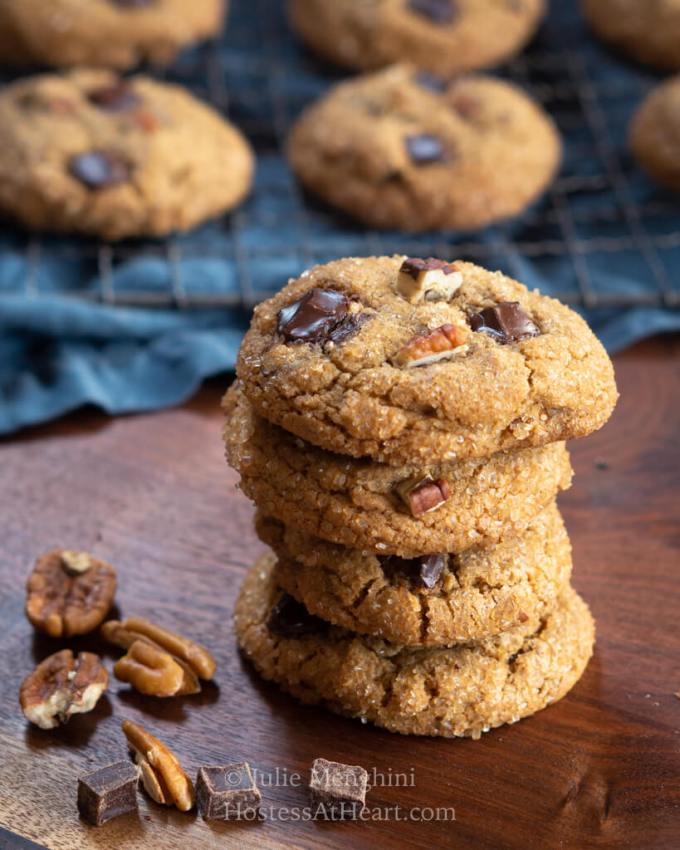 Stack of 4 cookies in front of a tray of cookies.