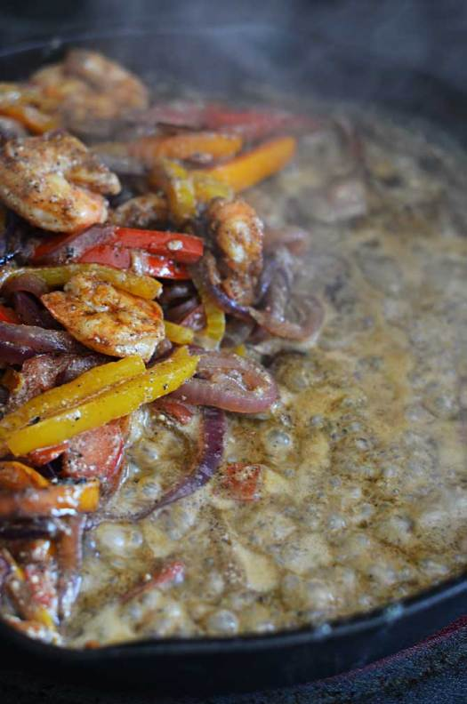 Saucy Cajun Shrimp Fajitas.  These super flavorful fajitas are cooked in their own sauce, and stuffed with shrimp, peppers, and onions.  Your family will beg you to make this for dinner all the time!  hostthetoast.com