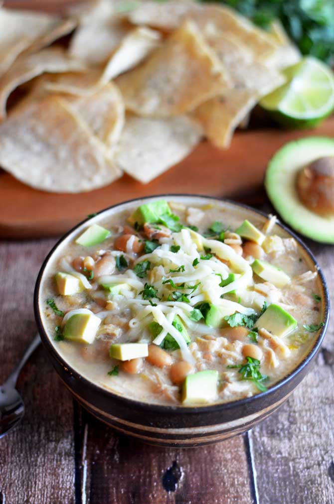 Crock Pot White Bean Chili.  This creamy white chili is absolutely delicious and easy to make in the slow cooker.  Also, it doesn't use any canned soups! | hostthetoast.com