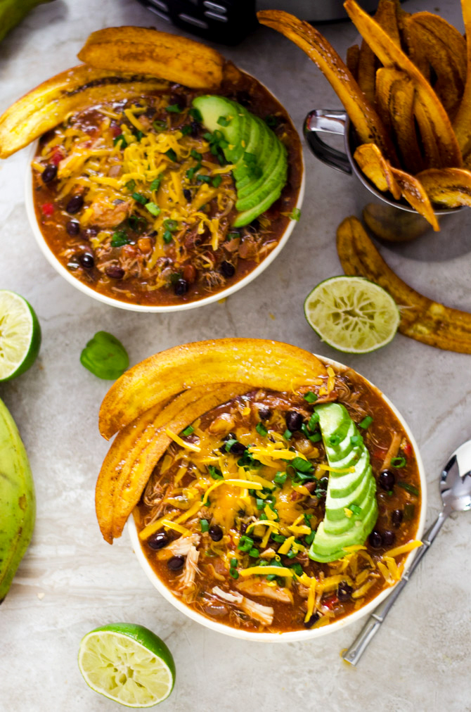 Slow Cooker Jamaican Jerk Chicken Chili with Plantain Chips. This set-it-and-forget-it shredded chicken chili takes island flavor straight to your bowl.   hostthetoast.com