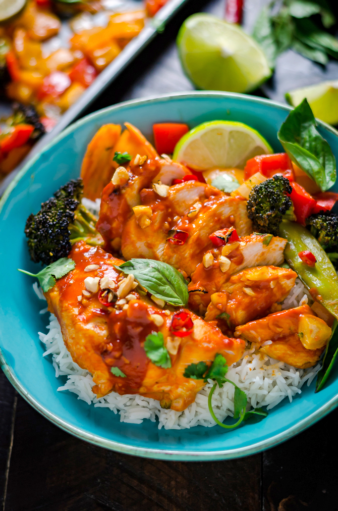 Sheet Pan Thai Peanut-Chili Chicken. This sweet and spicy glazed chicken and vegetable dish is a cinch to make for a weeknight dinner!   hostthetoast.com