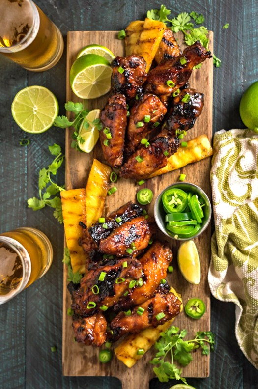 Hawaiian Huli Huli Grilled Chicken Wings. These island-inspired grilled wings are marinated and glazed with with sweet teriyaki flavors. Perfect for a cookout or game day tailgate. | hostthetoast.com