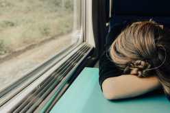 woman sleeping tired on train sleeplessness