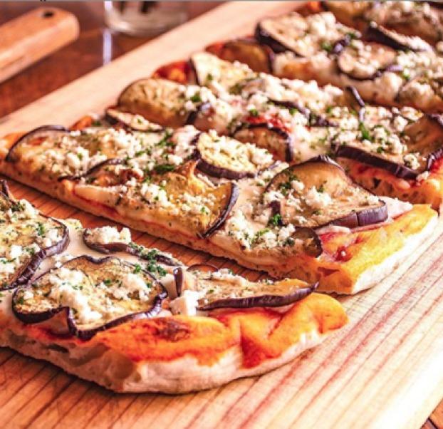 Tus restaurantes favoritos de pizza tienen servicio a domicilio - restaurante-pizzas-3