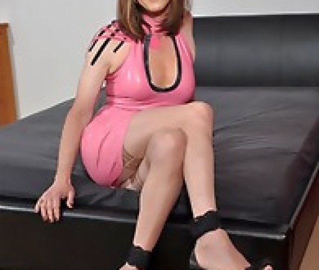 Sexy Crossdresser Dressed Up In A Gorgeous Pvc Outfit And Looking Very Desirable