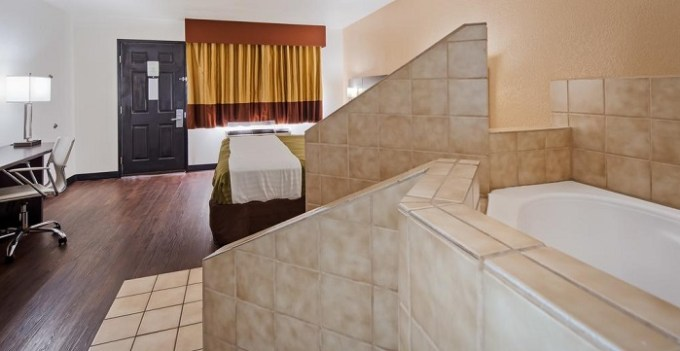 King room with a jetted tub in SureStay Hotel by Best Western Phoenix Airport hotel