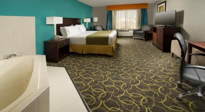 Room with a hot tub in Holiday Inn Express Hotel and Suites DFW-Grapevine hotel, TX