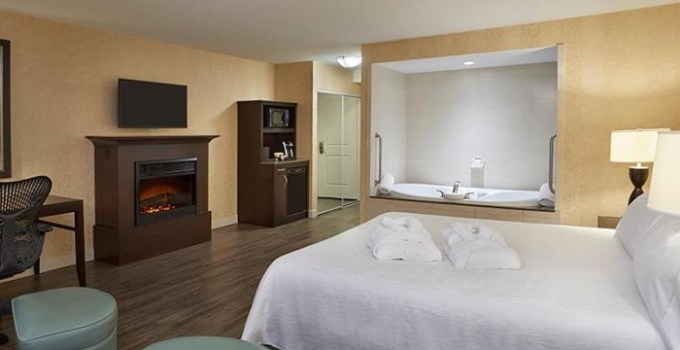 Hot Tub suite with a fireplace in Hilton Garden Inn Toronto Downtown, Ontario