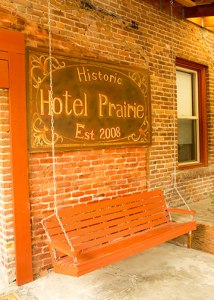 sign - Historic Hotel Prairie Est. 2008 - above bench swing