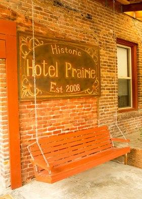 sign - Historic Hotel Prairie Est. 2008 - above bench swing